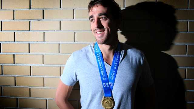 MATT Abood shows off his Swimming World Championships gold medal.