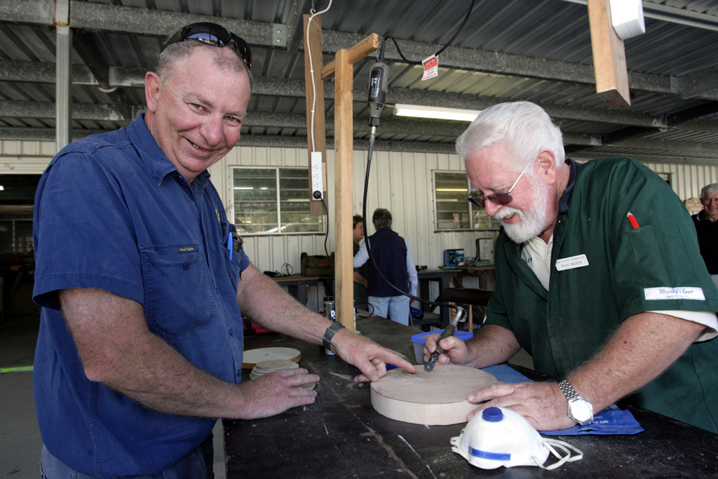 Jim Tutin from Ipswich and Ivan Medew from Bribie compete in the woodcrafters challenge to lift the spirits of the Ipswich club after losing equipment in the floods.