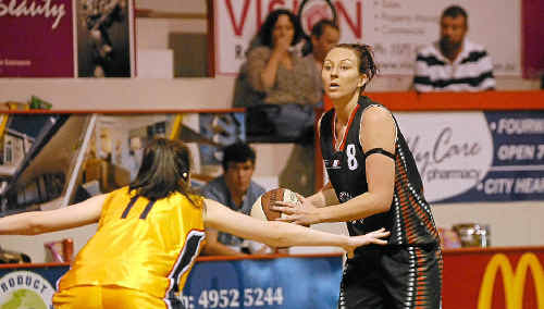 Angela Garden sumps up her attacking options for the Meteorettes during the regular 2011 QBL season.