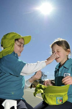 SUN SMART: Hannah Hogg and Emma Gray, both 7, get ready to play outside.