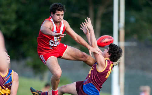 Coffs Swans ruckman makes a spectacular attempt to spoil a mark by Nambucca Valley's Jacob Howden in Saturday's AFL North Coast 1st semi final.