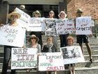 Activists call for a new ban on the export of live cattle from Australia during a protest outside Rockhampton City Hall yesterday.