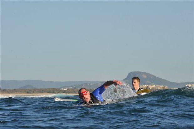 Ashley Robinson swallowed plenty of water in the choppy conditions in the Island Charity Swim around Mudjimba Island. The swim raised $75,000 this year.