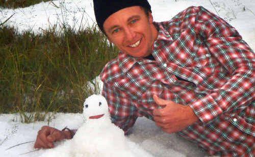 Wiley Cochrane hails his impromptu snowman.
