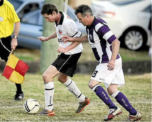 Rovers' Bobby Bugden and Pottsville's Glen Sheldrick.