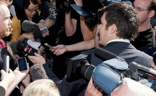 Defence lawyer Tim Meehan faces a media scrum outside Brisbane Magistrates Court yesterday morning.