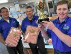 Carey Brothers Paul Carey holds the trophy for his winning pork sausages, with Sam Dight and Steve Carey.