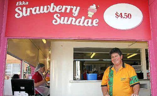 Anthony Mammino at the Ekka, where barricades have been installed in an effort to control the massive crowds swamping his stalls for a taste of Mammino's strawberry sundaes. MasterChef contestant Ellie Paxton-Hall (inset) has added to the popularity of the Childers ice cream, rating it a perfect 10 out of 10.