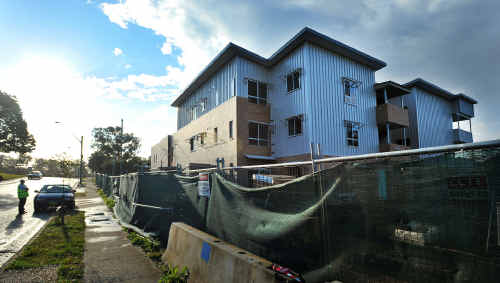 Security costs at the unfinished Harbour Dr housing block are skyrocketing.