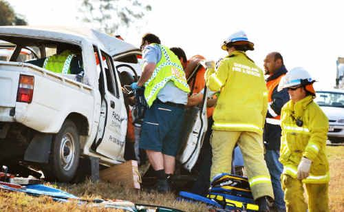 Emergency services workers at the scene of the crash east of Roma.