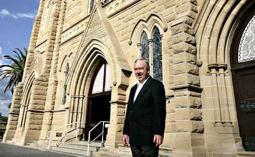 Bishop Brian Heenan stands outside the newly restored St Joseph's Cathedral since the scaffolding was taken down recently.