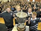 Getting their hands on the Cup at East State School yesterday are (from left) school captain Luca Greenleaf, Beth Foley (house captain), Isabella Petroff (school captain) and Sean Relph (house captain).