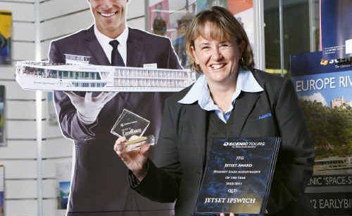Ipswich Manager Sharon Jones shows off awards won at the Jetset awards night.