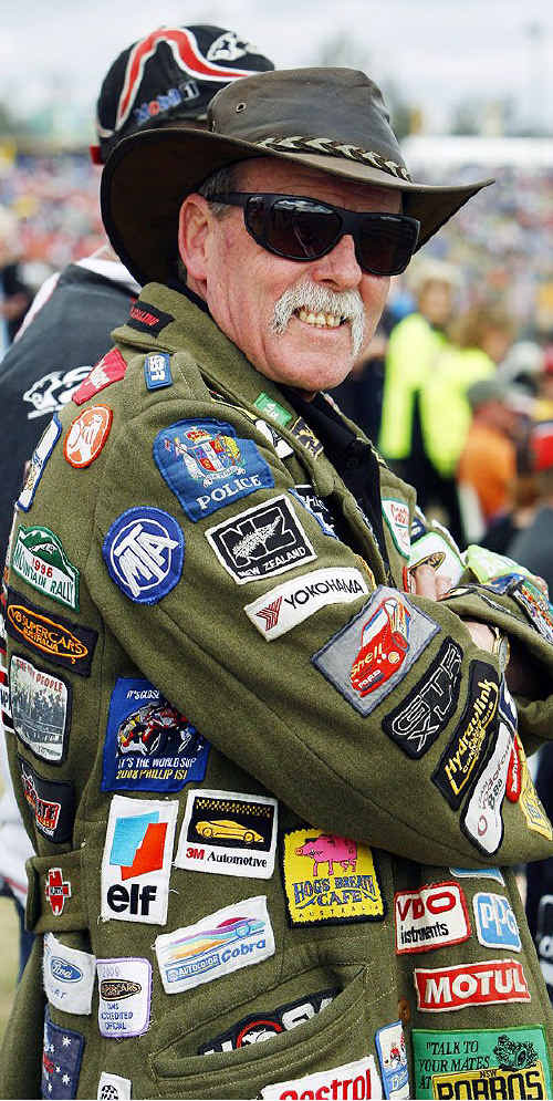 V8 fan Rex Baxter from Victoria sporting a coat of many badges collected over 15 years of V8 action.
