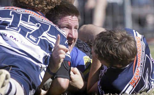 A happy Mitch Porter salutes the opening try for the Seagulls after carrying three or four Brothers players over the line with him during the grand final at Browne Park.