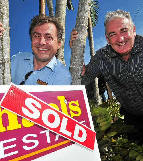 Sales agent Marc Hummer and Michael's Real Estate owner Michael Dempsey believe the property market is starting to improve.