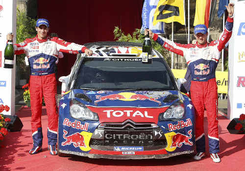 IMPORTANT WIN: French Sebastien Ogier, right, and co-pilot Julien Ingrassa celebrate on the podium after winning the Rallye Deutschland in Trier, Germany. AP