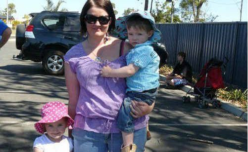 Charlotte, Kristy and Beau Barnes are among more than 150 families affected by the proposed closure of the Moranbah childcare centre.