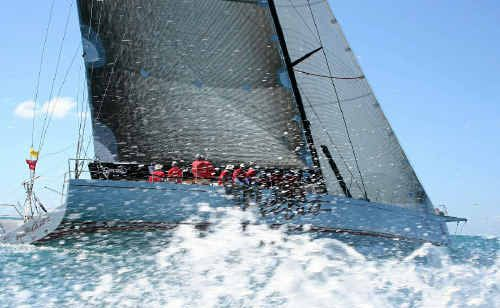 Maxi-yacht Wild Oats XI sets a fast pace in strong winds off Hamilton Island.