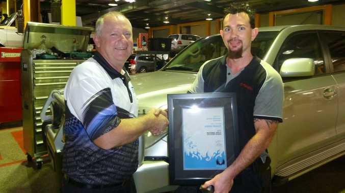 Jamie Witcher receives his award.