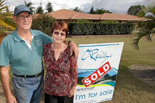 Joe and Lorraine Challacombe stand outside their newly bought home after moving in a week ago.