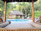 RELAX: The peaceful poolside setting at Toberua.