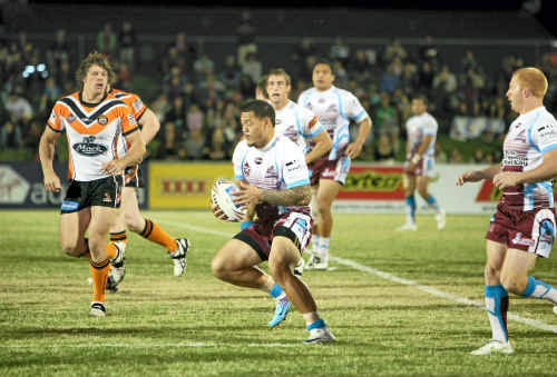 The Cutters' Leeson Ah Mau runs clear in last weekend's historic match at the new stadium.
