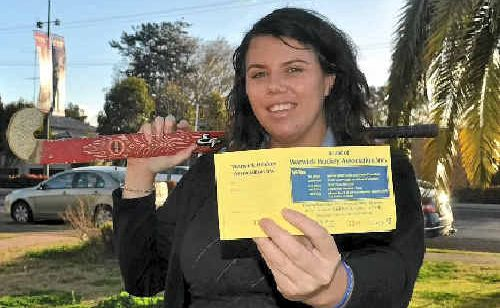 Lisa Hemmings is just one of the many hockey players in Warwick selling raffle tickets that will help their flood-damaged club.