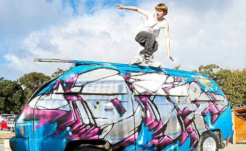 """ON THE EDGE: Finalist Brock Midgley """"grinds"""" along the top of a modified van during the titles."""