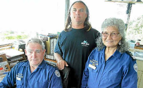 BAR DANGER: Owen and Andrea Danvers from Marine Rescue Brunswick with Rod Gray from Blue Bay Divers at the Brunswick Valley Marine Rescue tower.