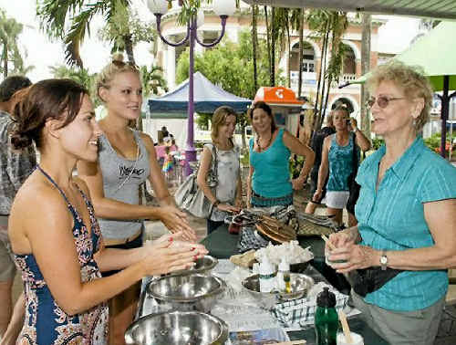 NICE SPOT TO STOP: Robertson and Kristy Heathcote sample a skin treatment from Bernadette Horner of Bush Essentials at the City Centre Markets.