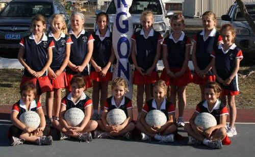 Mackay netballers with their new gear.