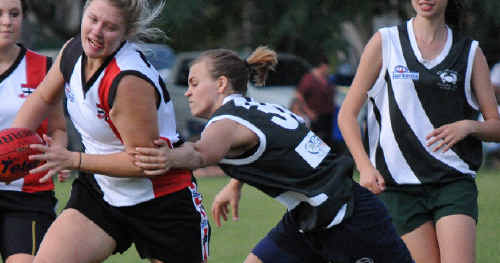Emma Aeschilmann (Mudcrabs) and Megan Hunt (BITS, right) will play together at the AFL State Titles at the Gold Coast this September.