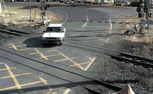 This picture of a motorist weaving around the lowered boom gate at a crossing in CQ has been provided to police.
