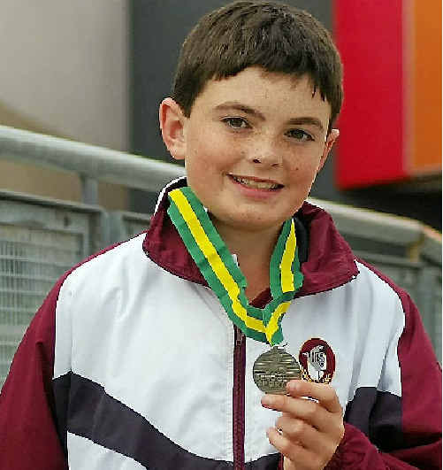 Warwick East State School student Jacob Reid with his medal at the nationals.