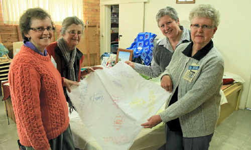 (From left) Margaret Darnell, Marg McNeil, Gail Mason and Carole Walsh present some of the work on show during Seniors Week.