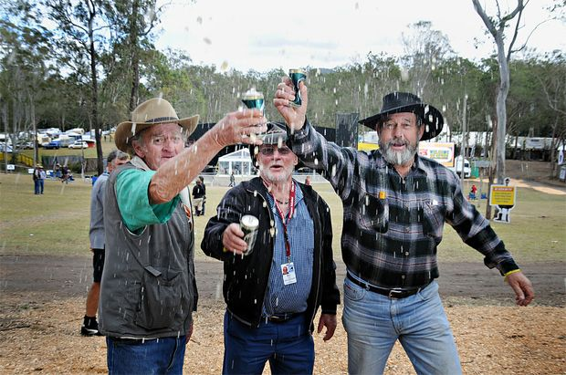 Dan Rowland, Bill McIntyre and Keith Robinson toast 30 years of Muster.