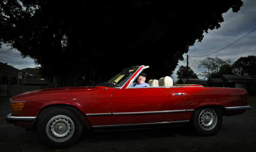 Grafton Vintage Motor Vehicle Club secretary Peter Arnull with his pride and joy, a 1974 Mercedes 450 SL convertible, which he will proudly have on show during this weekend's Show and Shine meeting at the Grafton Showground.