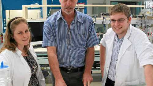 PhD student Rebecca Vella, CQUniversity's faculty services manager Graeme Boyle and PhD student Douglas Jackson check over the plans for a new allied health clinic.