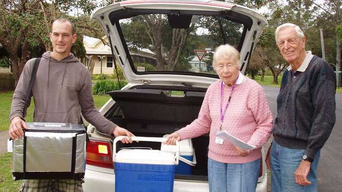 MEALS ON WHEELS: Val Rose with her husband John Rose and Open Arms Care Inc. staff member Paul D'Arcy Ryan.