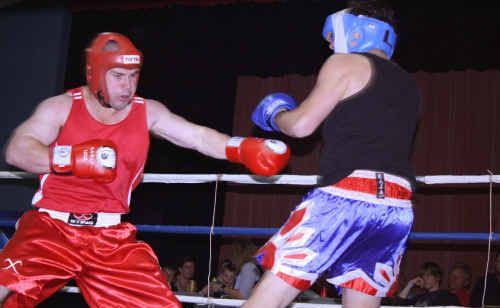 Steve Parry (red) from Fighters Inc gym in Emerald takes on Lewis Robinson from Sarina.
