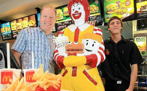 McDonald's owner John Davis with his son Corban Davis celebrate McDonald's 40th birthday with Ronald McDonald himself.