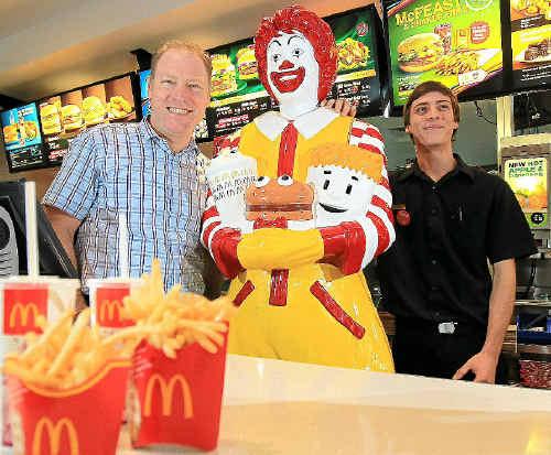 McDonald's owner John Davis with his son Corban Davis celebrate McDonald's 40th birthday with Ronald McDonald himself.