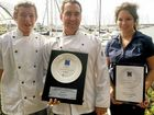 Sous chef Chris Richardson, executive chef Matt Smith and service supervisor Tiffany Unnells proudly show their awards from the Restaurant and Catering Industry Awards for Excellence.