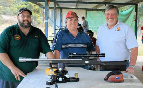 Winner Damien Webb, SSAA Warwick president Mal Smith and winner Russell Powell at the state championships at Risdon Range.