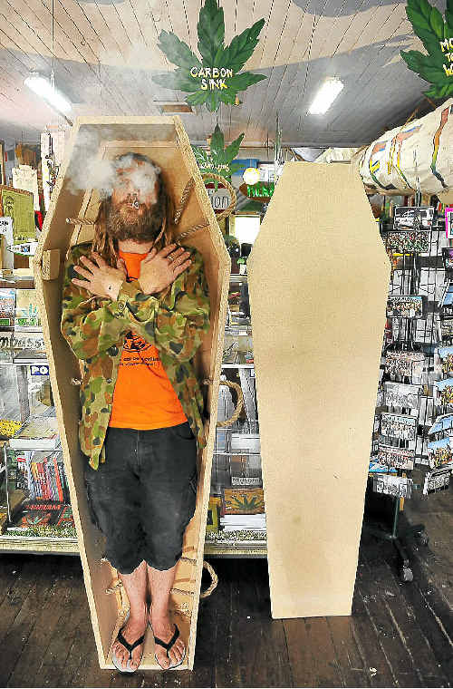 A Nimbin resident strikes a pose in the first hemp coffin produced by the Nimbin Hemp Embassy.