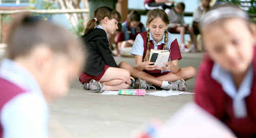 Slade Point State Primary School's Mere Sellars (left), Kenzie Matheson, Deanna Louttit and Libby Surha were among more than 250 students who took part in Literacy on the Lawn yesterday for National Literacy and Numeracy Week.