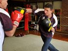 Boxer Neil Palmblad (right) trains at Toowoomba PCYC with trainer Bruce Titter.