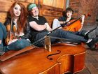 The Urchins, members Imogen Gilfedder-Cooney, Caleb Donovan and Nils Hobiger will perform in the Queen Street Mall during the Brisbane Festival.