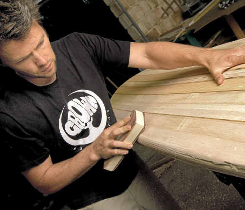 Grown Surfboards founder Andrew Wells with a new wooden surfboard creation. www.craigparry.com.au